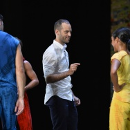"""French choreographer Benjamin Millepied speaks to LA Dance Project dancers during a rehearsal of his new creation """"On The Other Side"""" at the Champs Elysee Theater in Paris on September 14, 2016."""