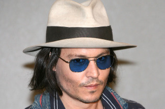 "File photo:  Johnny Depp arrives at the Narita International Airport for the Japanese premiere of 'Pirates Of The Caribbean: At World's End' May 22, 2007 in Narita, Japan.  Disney said they have just begun filming ""Pirates of the Caribbean: On Stranger Tides,"" the fourth installment of the ""Pirates of the Caribbean"" franchise. Depp returns to his leading role as Captain Jack Sparrow."