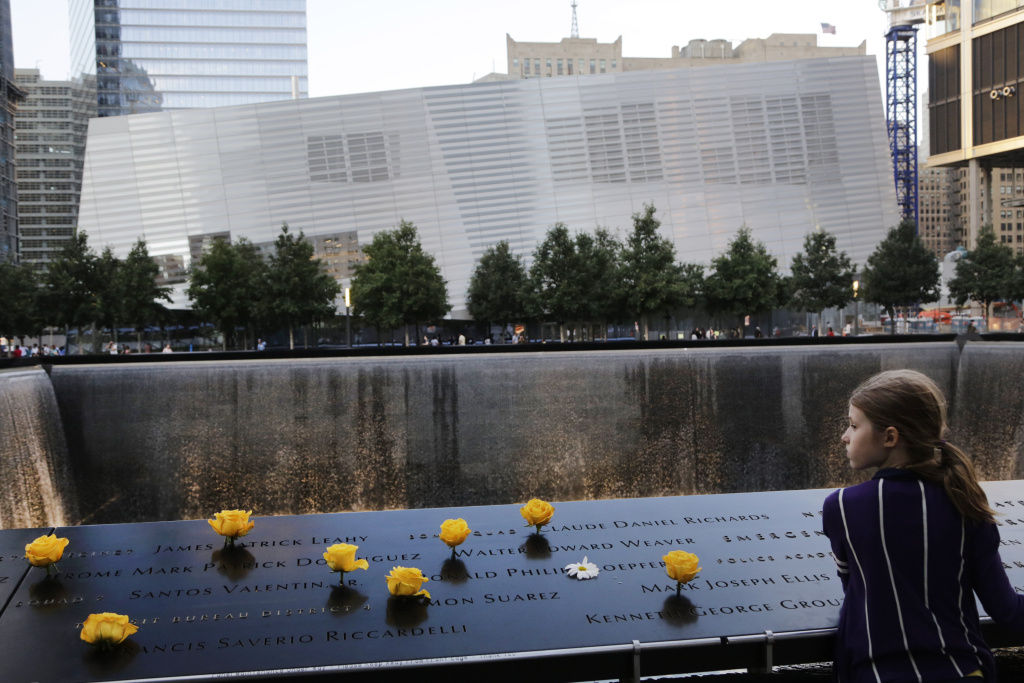 Charlotte Newman, 8, visits the National September 11 Memorial and Museum, Sunday, Sept. 8, 2013 in New York.  The long-awaited museum dedicated to the victims of the Sept. 11 terror attacks will open to the public at the World Trade Center site on May 21, officials announced Monday, March 24, 2014.