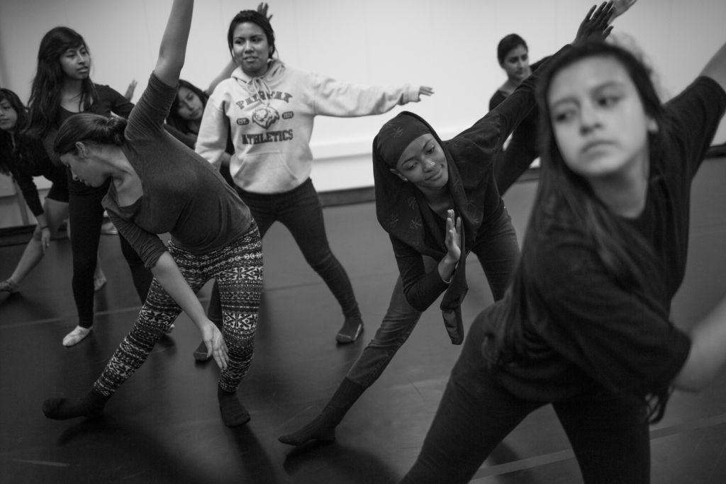 High school students dance in an after-school program. In England, lawmakers have debated whether to include the arts in the English Baccalaureate.