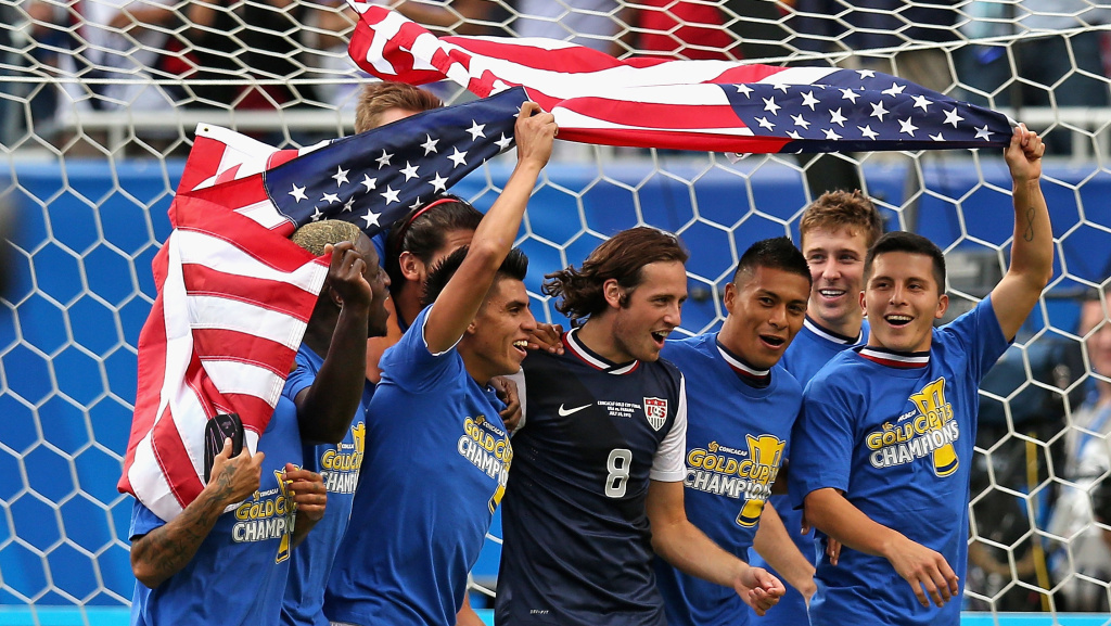 Members of the U.S. men's soccer team take a lap around the field after beating Panama 1-0 to capture the CONCACAF Gold Cup on Sunday in Chicago.