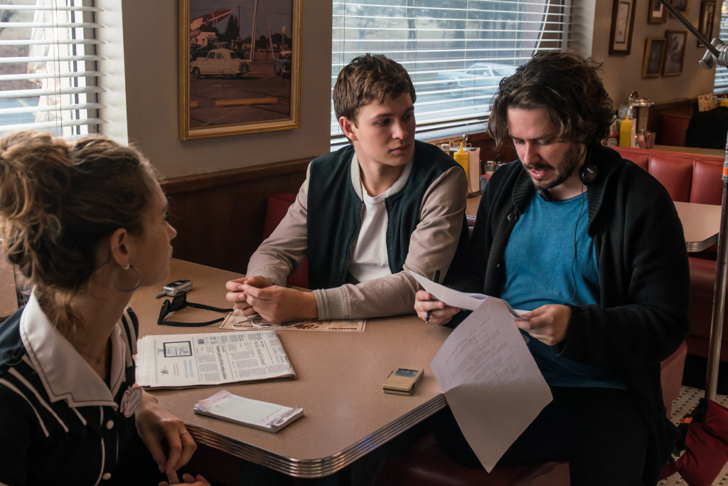 BTS/ Director Edgar Wright with Lily James and Ansel Elgort (center) on the set of TriStar Pictures'