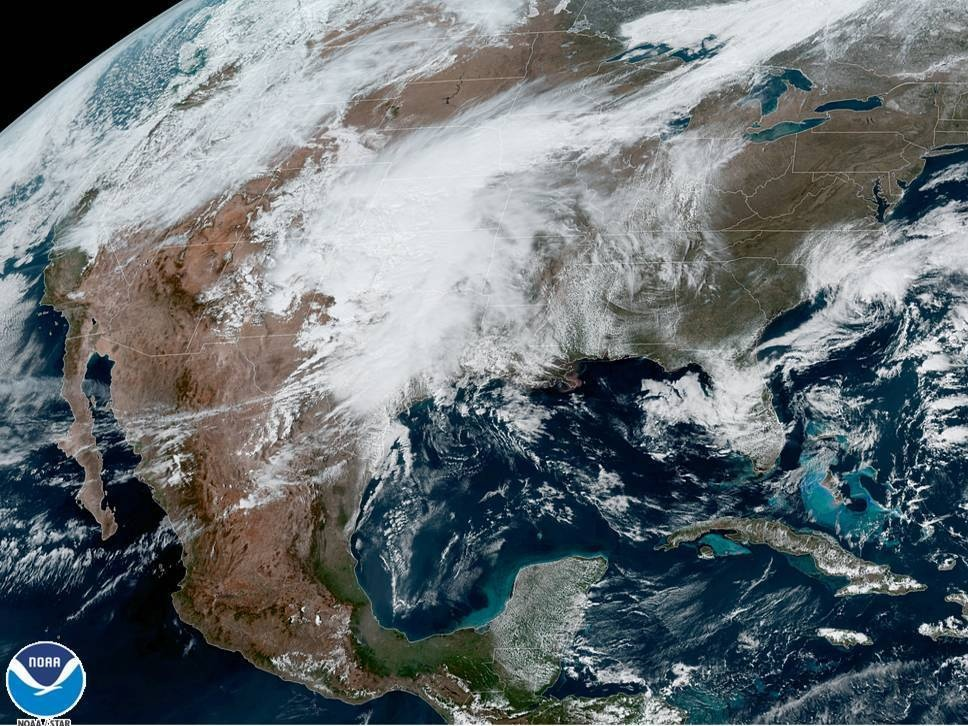 A U.S. satellite captures cloud cover over North America on Monday. The National Oceanic and Atmospheric Administration announced it has upgraded its weather forecasting model to use more satellite weather data.