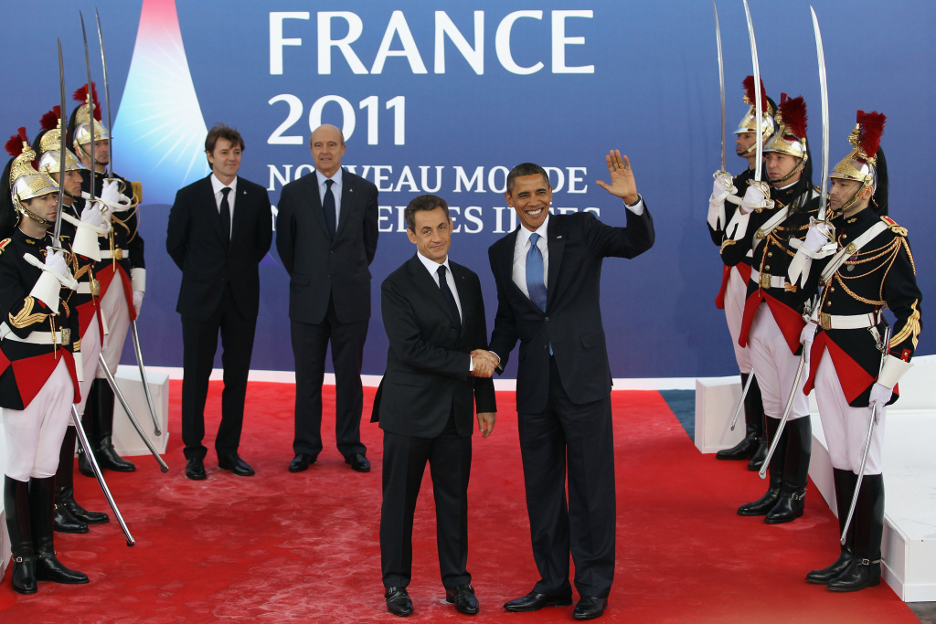 CANNES, FRANCE - NOVEMBER 03:  US President Barack Obama is welcomed by the French President Nicolas Sarkozy to the G20 Summit on November 3, 2011 in Cannes, France. World's top economic leaders are attending the G20 summit in Cannes on November 3rd and 4th, and are expected to debate current issues surrounding the global financial system in the hope of fending off a global recession and finding an answer to the Eurozone crisis.   (Photo by Dan Kitwood/Getty Images)