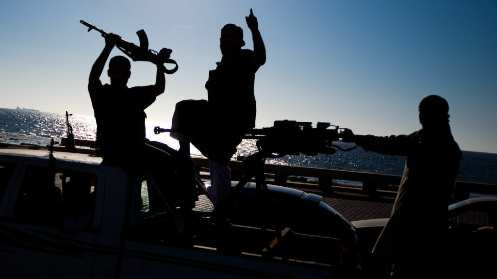 Islamists with weapons stage a rally in favor of Islamic law along the corniche in Benghazi, in eastern Libya, the birthplace of the Libyan uprising that ousted Moammar Gadhafi.