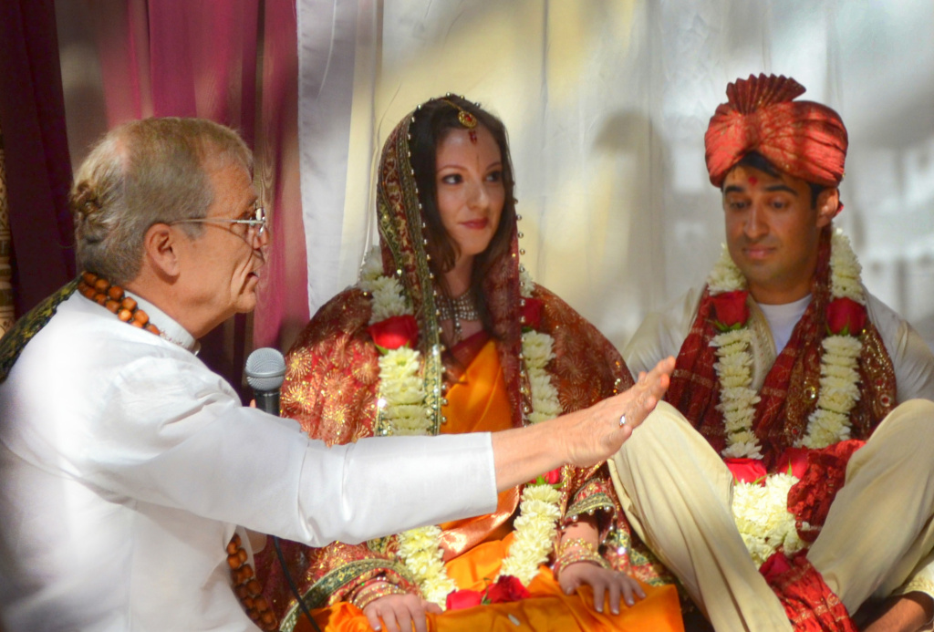 Hindu priest Shukavak Dasa (left) officiates at the wedding of Stephanie Young (center) and Neil Bajpayee in Pasadena, Calif., on May 4, 2013.