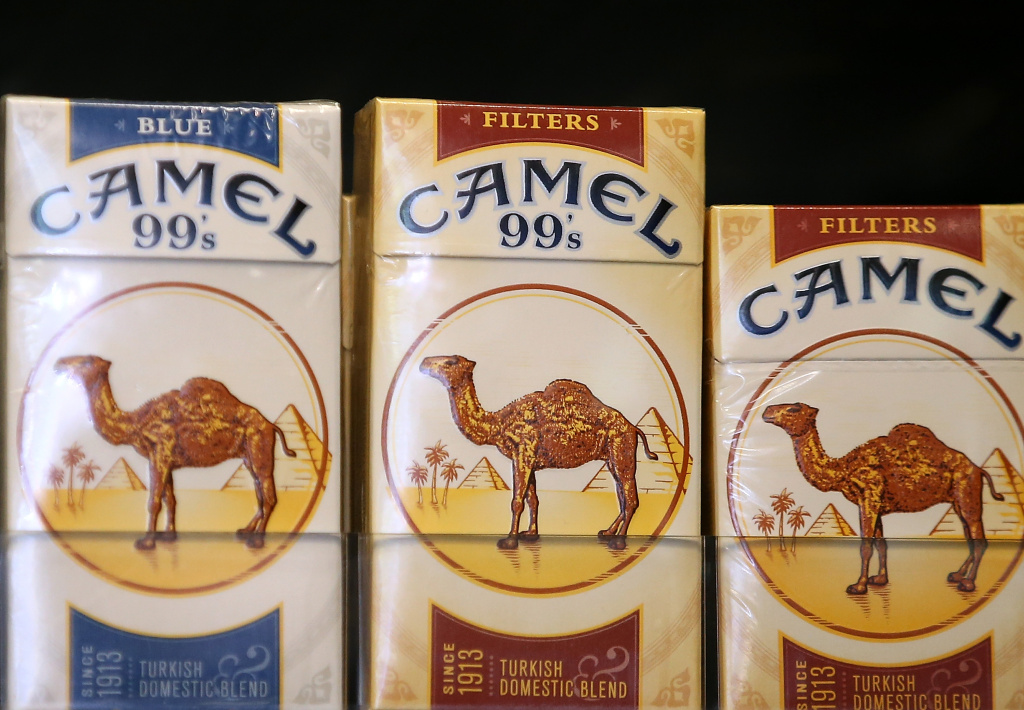 Camel cigarettes, manufactured by Reynolds Amercian, are displayed at a tobacco shop on July 11, 2014 in San Francisco, California.