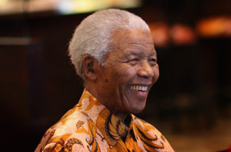 Nelson Mandela smiles during a lunch to Benefit the Mandela Children's Foundation as part of the celebrations of the opening of the new One&Only Cape Town resort on April 3, 2009 in Cape Town, South Africa.
