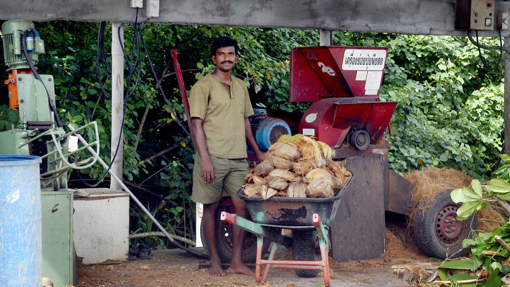 A hotel employee prepares coconut husks for recycling into rope at the luxury Soneva Fushi island resort in the Maldives. It's just one of many initiatives the resort is taking to reduce food waste.