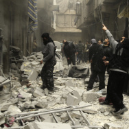 "Syrian look up after an apparent airstrike by forces loyal to President Bashar Assad in Aleppo, Syria, on Monday. A new report, released Monday, alleges ""systematic"" torture and killing by the Assad regime."