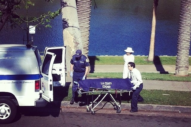 The Coroner's Office removing a dead woman's body from Echo Park Lake on Saturday, April 26, 2014.