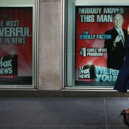 An advertisement for Bill O'Reilly's top-rated Fox News show is displayed in the window of the News Corporation headquarters on April 5, 2017 in New York City.