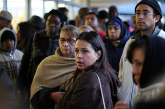 People wait in line before dawn for free healthcare service at the Remote Area Medical (RAM) clinic at the Los Angeles Sports Arena on April 27, 2010 in Los Angeles.