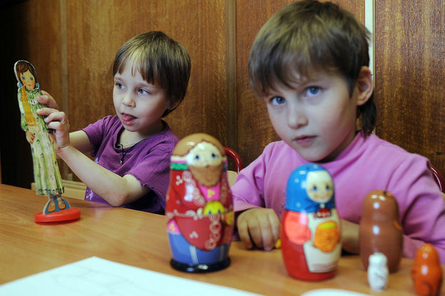 Children play in an orphanage in Moscow. Russian president Vladimir Putin has just signed a law that bans further adoptions of Russian children by families in the United States.