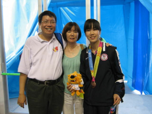 Erica with her parents in Guadalajara, Mexico after winning the bronze medal with the U.S. Women's Table Tennis team. Now she's going for the gold, after qualifying for Team USA's Olympic team.