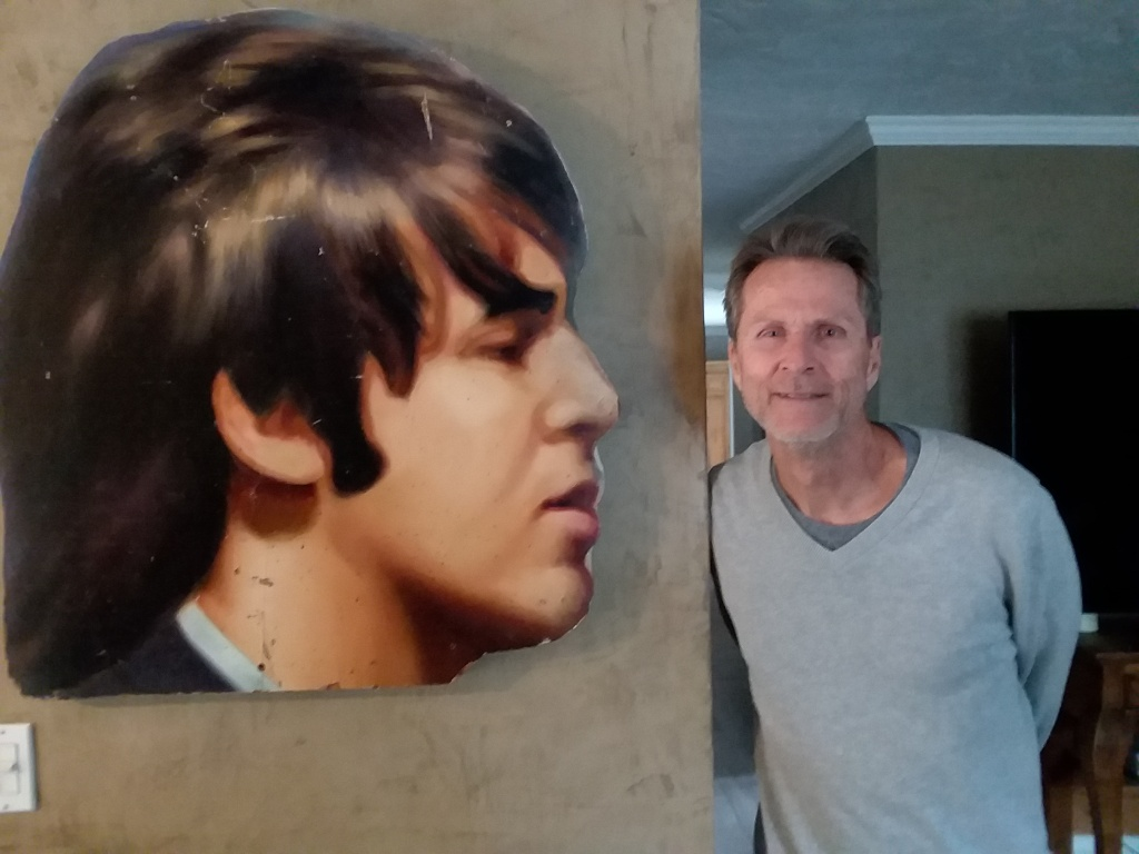 Robert Quinn with Paul McCartney's head, which was cut off from the