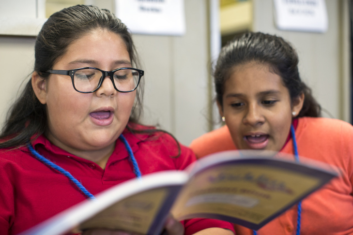 Adelaide Price Elementary School 6th-graders Arlene Garibay, left, and Viviana Garcia take part in a rehearsal for