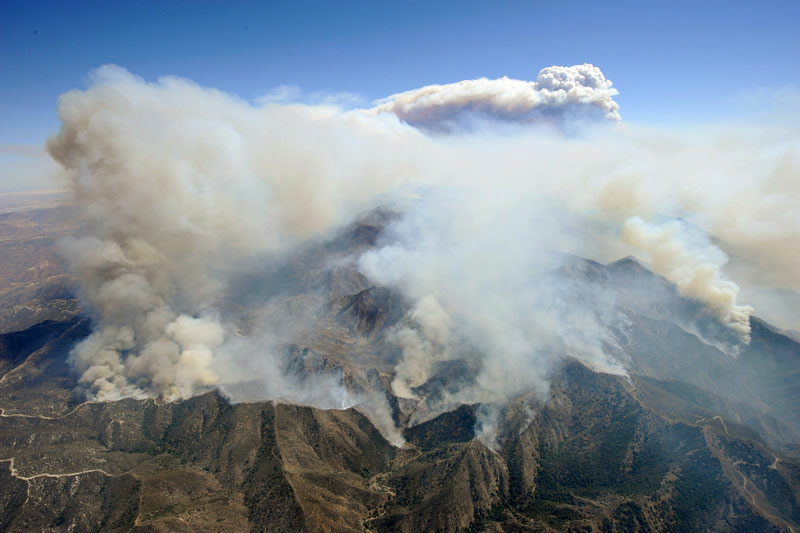 Mushrooming clouds rose to sky as the deadly Station Fire gradually marched west towards the communities of Sunland and Tujanga on August 31, 2009 in Los Angeles, California.