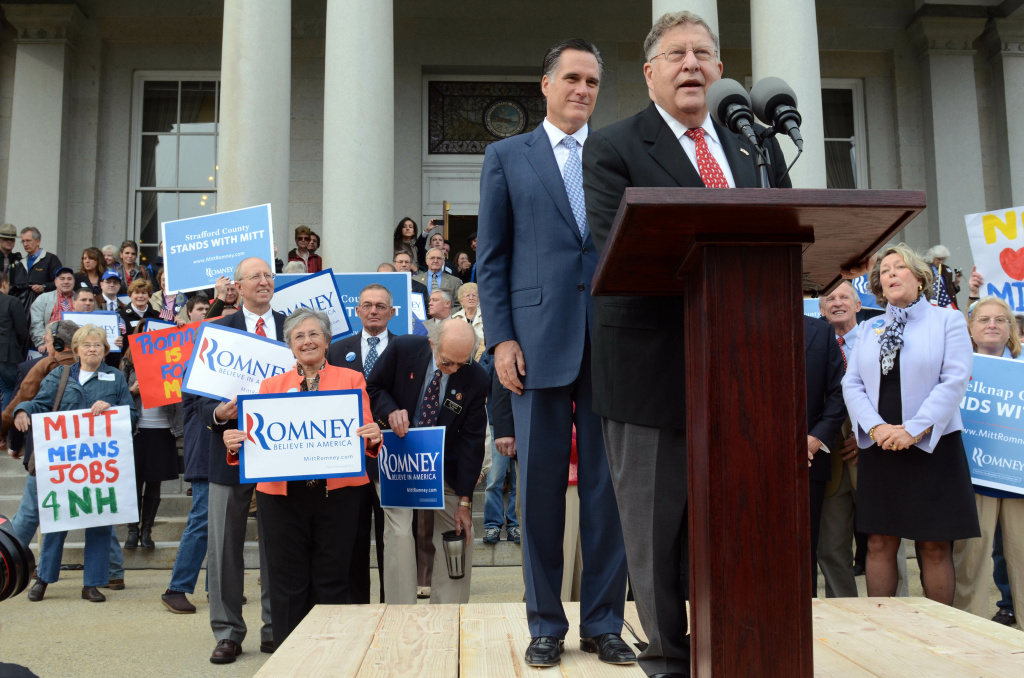 Republican presidential candidate former Massachusetts Gov. Mitt Romney  listens as former New Hampshire Governor John Sununu endorses him for President outside the Statehouse October 24, 2011 in Concord, New Hampshire. Romney also filed the paperwork necessary to be on the New Hampshire primary ballot.