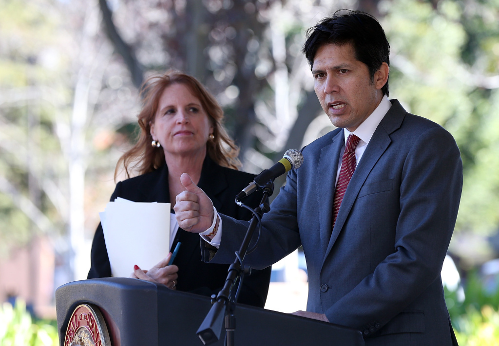 California state senator Noreen Evans (D-Santa Rosa) (R) looks on as state senator Kevin de Leon (D-Los Angeles) speaks during a news conference on November 22, 2013 in Santa Rosa, California.