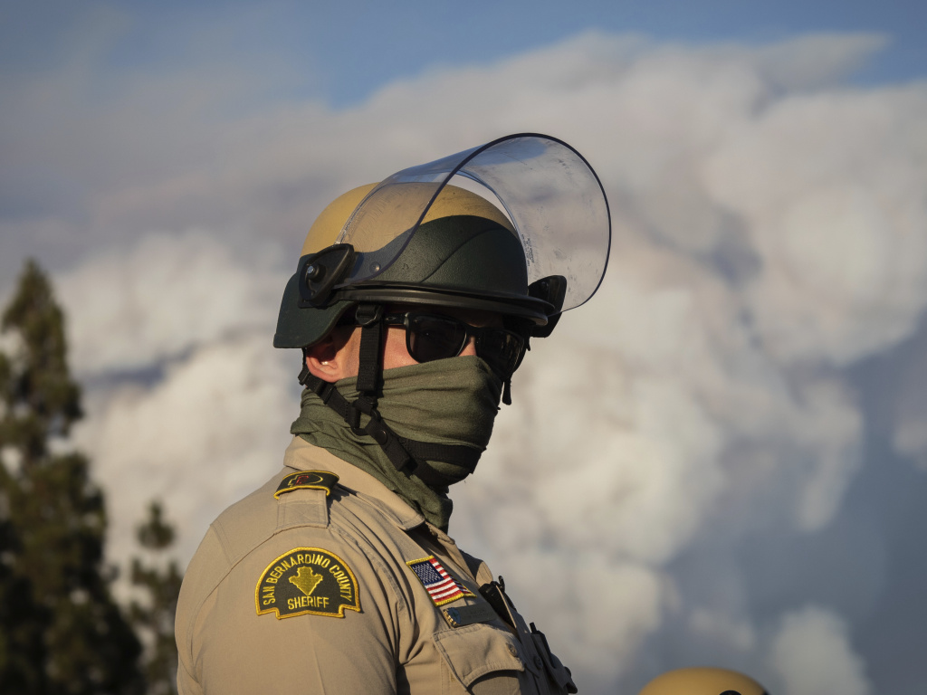 A San Bernardino County sheriff's deputy at a Black Lives Matter protest this month. The national debate following the death of George Floyd has raised questions about 'qualified immunity' for cops.