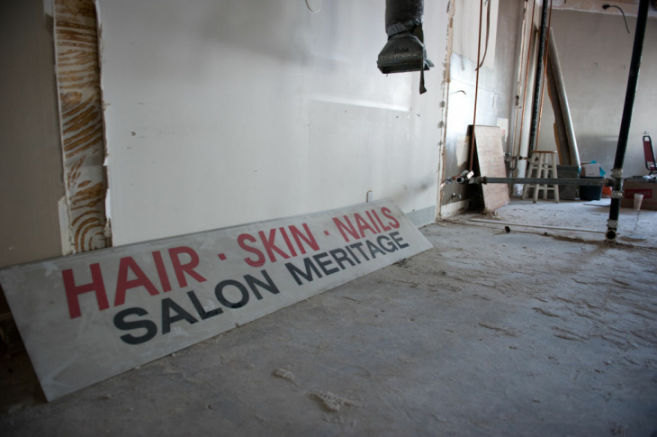 Very little of the original store design is left, as the interior is gutted, but the original Salon Meritage sign remains.
