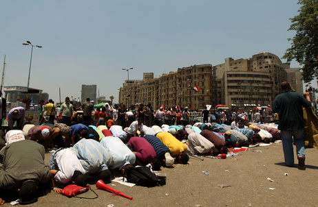 "Egyptian supporters of their new president-elect, Muslim Brotherhood leader Mohamed Morsi, perform noon prayers in Cairo's Tahrir Square, one day after Morsi was elected as the country's ""first civilian president"" on June 24, 2012."
