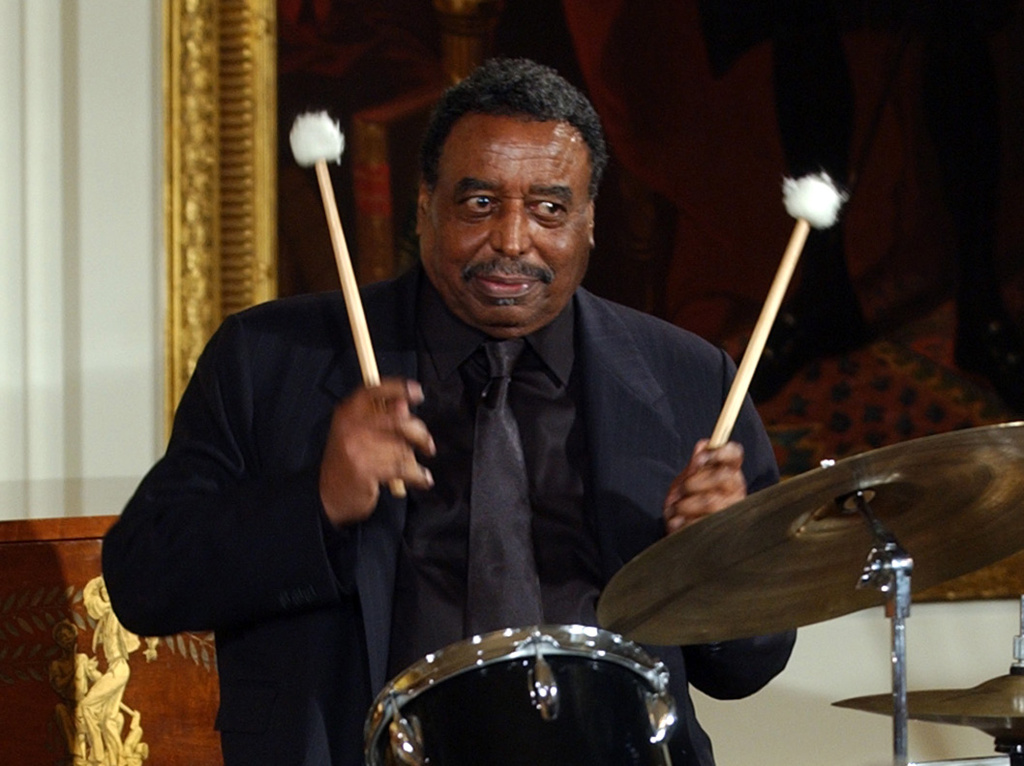 This June 22, 2004 file photo shows Chico Hamilton, a recipient of the he National Endowment for the Arts Jazz Masters Fellowship, performing a drum solo in the East Room of the White House during a reception to honor Black Music Month, in Washington.