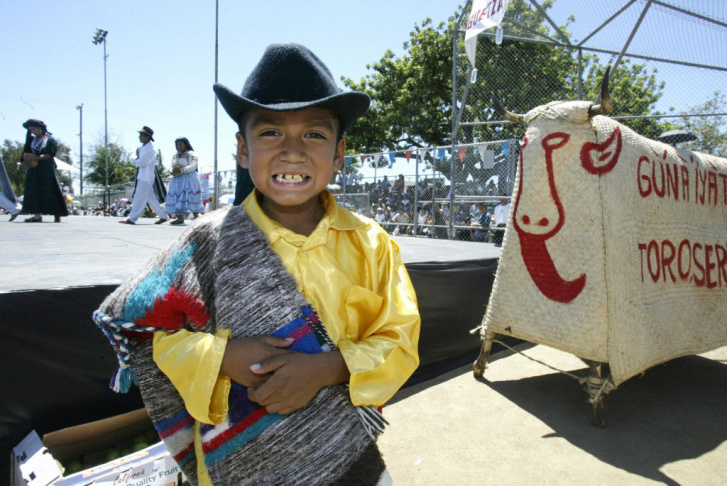 A boy wearing a traditional Oaxcan costu