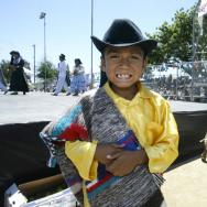 A boy wearing a traditional Oaxcan costu