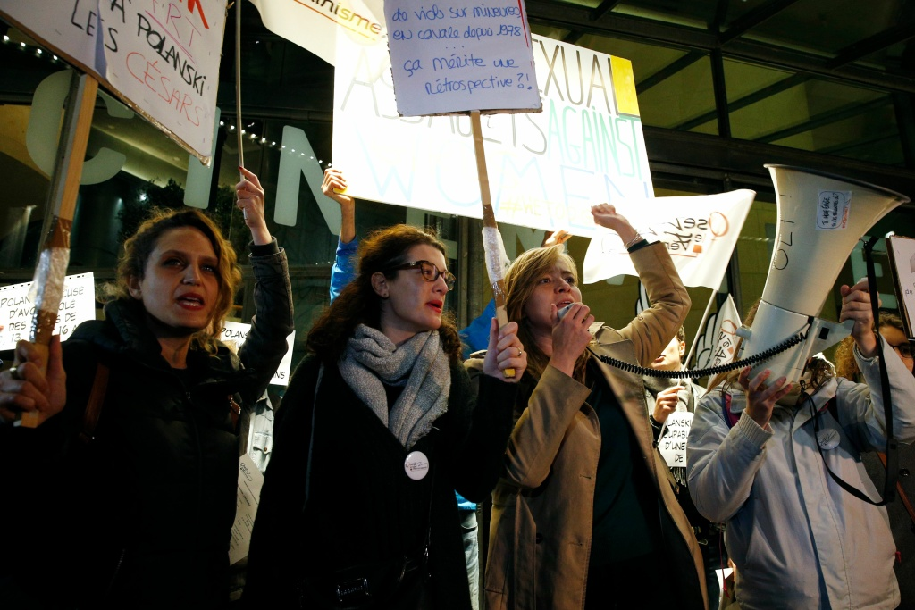 Protesters hold placards during a demonstration on October 30, 2017, outside the Cinematheque Francaise film archive in Paris, where filmmaker Roman Polanski, accused of a string of sexual assaults, is expected to attend a retrospective of his work.