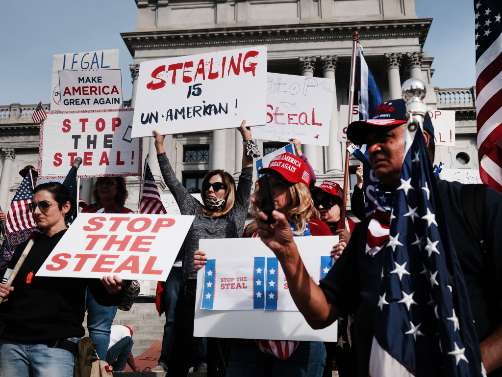 People call for stopping Pennsylvania's vote count Thursday at the state Capitol in Harrisburg. False claims of voter fraud and calls to protest have spread on social media, leading Facebook to take down one large group.