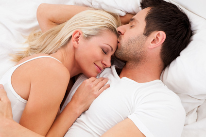 Loving couple lying in bed.