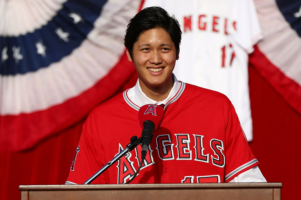 Shohei Ohtani speaks onstage during his introduction to the Los Angeles Angels of Anaheim at Angel Stadium of Anaheim on December 9, 2017 in Anaheim, California.