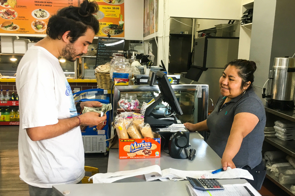 Patricia Moguel rings up a customer at the Mercado Benito Juarez in Koreatown.