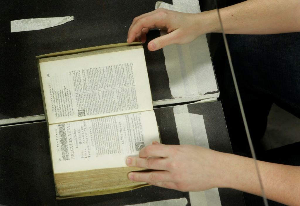 In this file photo, Courtney Mitchel helps a giant desktop machine digest a rare, centuries-old Bible in Ann Arbor, Mich., March 21, 2008. Mitchel was among hundreds of librarians from Minnesota to England helping Google Inc.'s Book Search create digital versions of all the estimated 50 million to 100 million books in the world and make them readily available online for free for people everywhere. The practice sparked a decade long legal battle, but a federal appeals court ruled Friday, Oct. 16, 2015, that Google is not violating copyright laws by digitizing books for its massive online library.