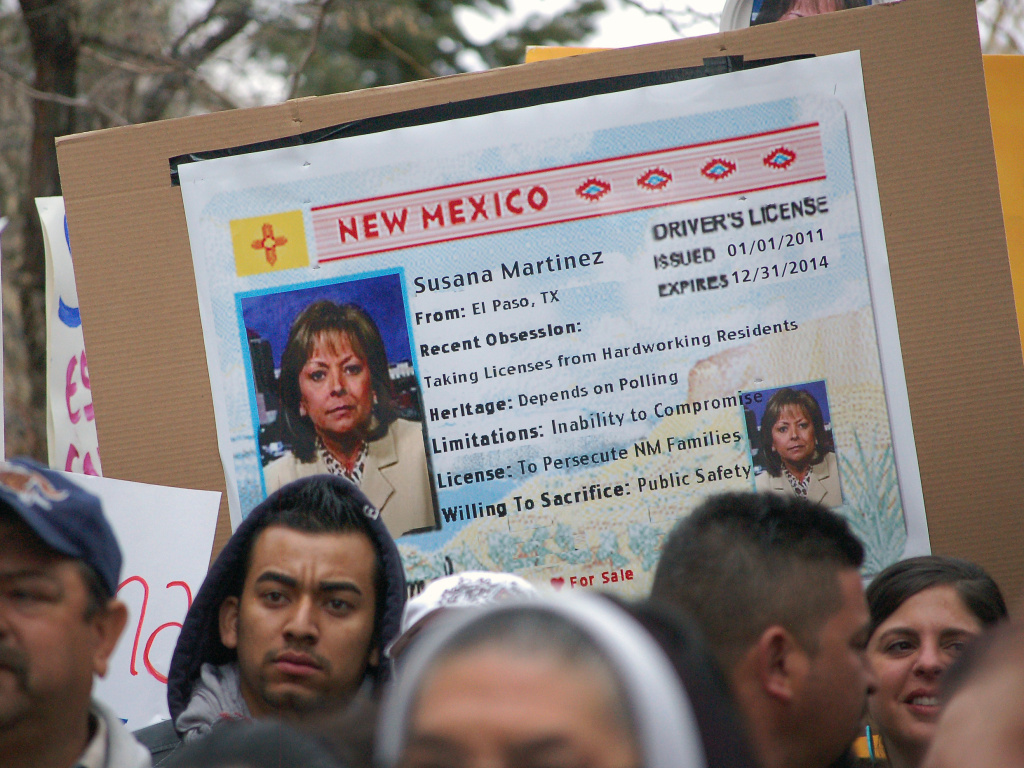 Immigrant advocates use an image of New Mexico Gov. Susana Martinez on a mock state driver's license during a 2012 rally in Santa Fe to protest her proposal to repeal a state law that allows illegal immigrants to obtain driver's licenses.