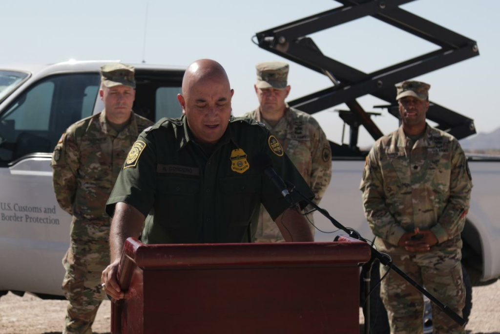Border Patrol spokesman Ramiro Cordero appears with service members at a June press conference in Sunland Park, New Mexico.