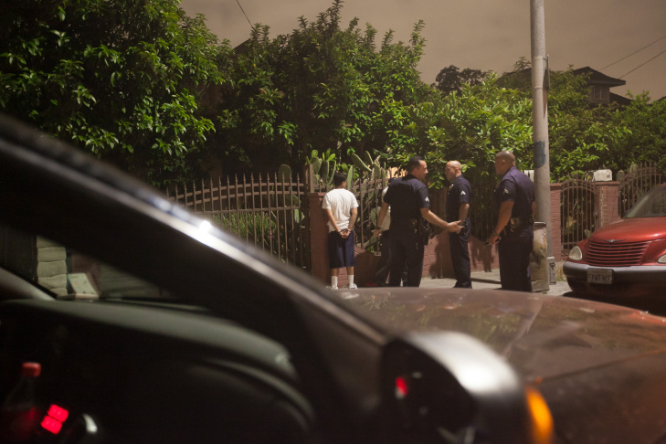 Los Angeles Police Sergeant Raul Jovel enters data in a field report after making a stop on E. 28th St. to check on some metro officers who were doing a search at a home on Tuesday, May 12, 2015 in Los Angeles, Calif. The search later turned up methamphetamines packaged for sale, a scale,  and ammunition including .380 auto,  .40 caliber, .357 magnum and rifle rounds, according to metro officers who were at the scene.