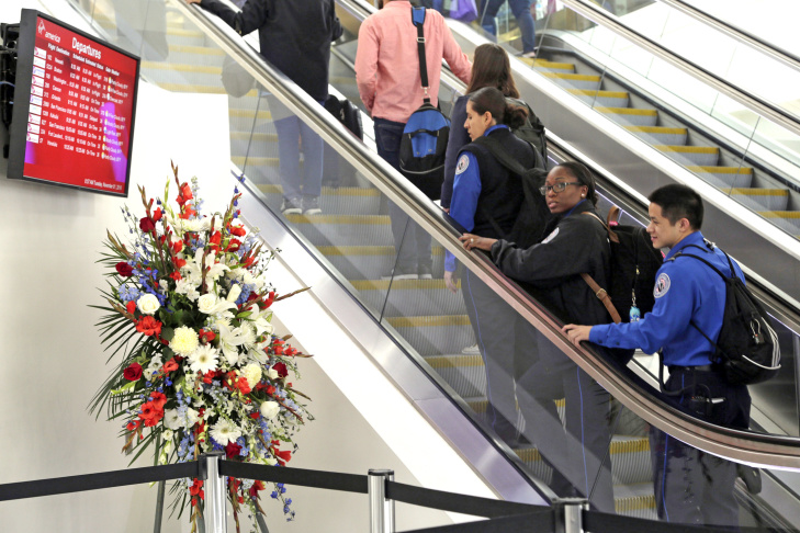 Transportation Security Administration personnel take part in a formal ceremony of remembrance on the third anniversary of a shooting rampage that killed a TSA officer and wounded others at Los Angeles International Airport Tuesday, Nov. 1, 2016. Officers, travelers and others at the airport observed a moment of silence at 9:20 a.m. to honor TSA agent Officer Gerardo Hernandez, who was killed on Nov. 1, 2013. Paul Ciancia, 26, has pleaded guilty to murder and 10 other charges, and is scheduled to be sentenced to life in prison on Monday, Nov. 7.