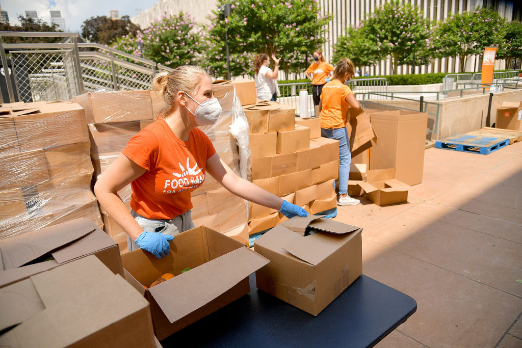 New Yorkers in need receive free produce, dry goods, and meat at a Food Bank For New York City distribution event at Lincoln Center on July 29, 2020 in New York City.