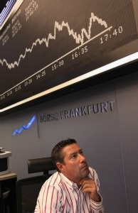 A trader works at the Frankfurt Stock Exchange on the first day following the U.S. debt downgrade.