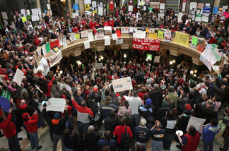 Protestors demonstrate in the rotunda of the state capitol on February 24, 2011 in Madison, Wisconsin.
