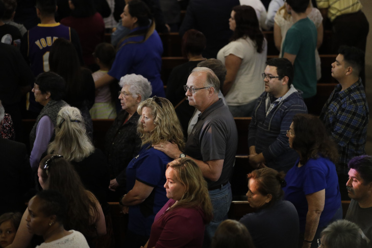 People attend a prayer service to honor the shooting victims at North Park Elementary School, Monday, April 10, 2017, in San Bernardino, Calif. A man walked into his estranged wife's elementary school classroom in San Bernardino and opened deadly fire. (AP Photo/Jae C. Hong)