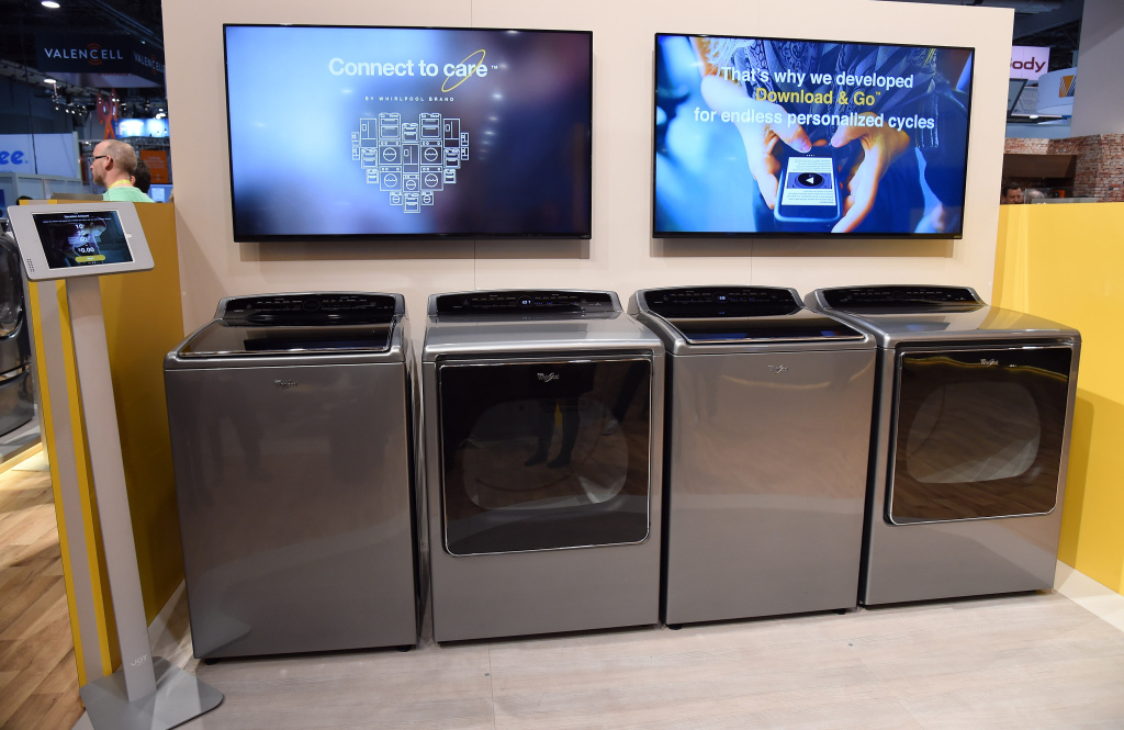 LAS VEGAS, NV - JANUARY 06:  Whirlpool's new Smart Top Load washer and dryer are displayed at the 2015 International CES at the Sands Expo and Convention Center on January 6, 2015 in Las Vegas, Nevada. The units can connect with the Nest Learning Thermostat remotely and offer custom downloadable cycles. Through Whirlpool's Connect to care program on the Whirlpool Mobile app, users can choose to donate any mount of money per load of laundry to Whirlpool's corporate partner, Habitat for Humanity. CES, the world's largest annual consumer technology trade show, runs through January 9 and is expected to feature 3,600 exhibitors showing off their latest products and services to about 150,000 attendees.