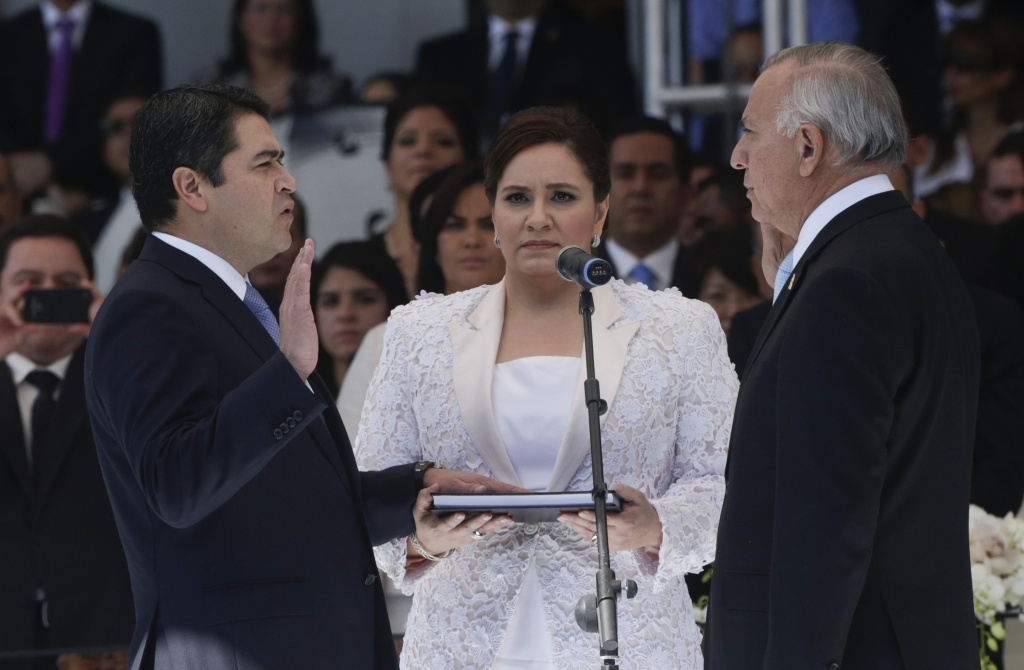 Honduran First Lady Ana Rosalinda de Hernandez said she will come to the US to retrieve her country's children. Here, she is at the swearing-in of her husband Pres. Juan Orlando Hernandez.