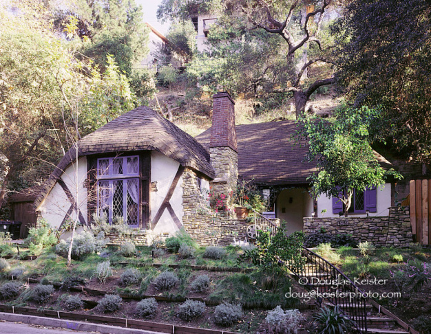 The Spadena house in Beverly Hills is perhaps the ultimate example of Storybook Style, as well as its most literal link to the film industry. The house was designed by Harry Oliver in 1921 and constructed in Culver City to provide offices and dressing rooms for a movie studio. With its serpentine fascia boards and cartoonishly lopsided walls and roofs, the entire design is a cleverly-wrought caricature of dilapidated antiquity. The house appeared in a number of silent films of the era before being moved to Beverly Hills in 1934 and converted into a residence.