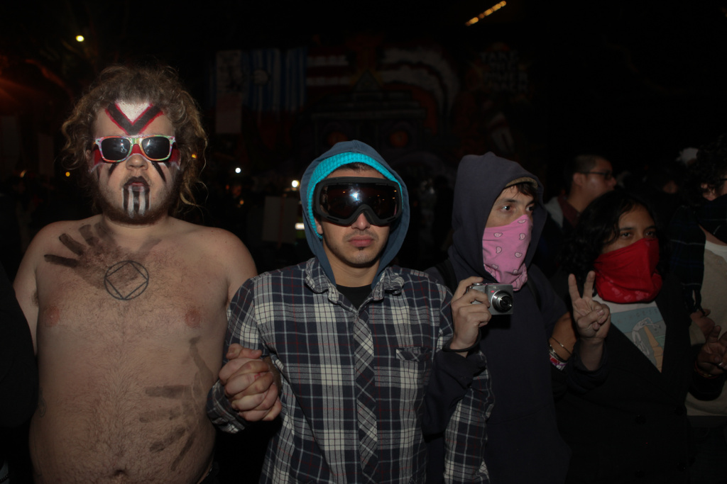 Occupy Los Angeles demonstrators linked arms as they waited for their arrest.