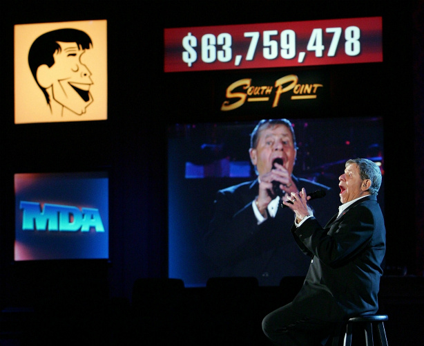 Entertainer Jerry Lewis sings at the end of the 42nd annual Labor Day Telethon to benefit the Muscular Dystrophy Association at the South Point Hotel & Casino September 3, 2007 in Las Vegas, Nevada. That year's telethon raised USD 63,759,478.