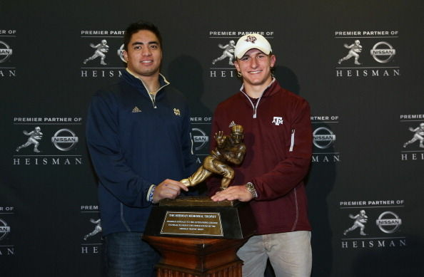 Manti Te'o and Johnny Manziel pose in front of the Heisman Award Trophy in New York City on December 7, 2012.